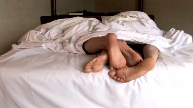 HD: Feet of Couple in Bed Couple in bed trying to find comfortable sleeping position sexual activity sex naked couple stock videos & royalty-free footage