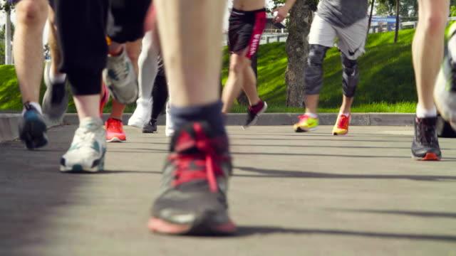 Feet of running people video