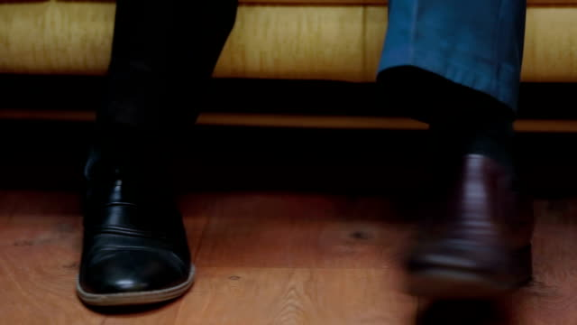 Feet Of Several Men In Shoes Stamping Close-up shot of three men's feet in black shoes stamping on the floor. stamping feet stock videos & royalty-free footage