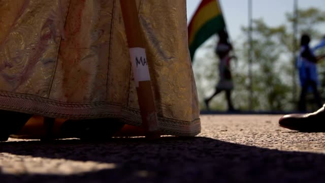 Feet of students walking with national costumes video