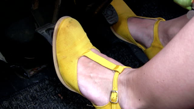 Feet on Car Pedals video