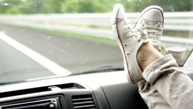 Feet on van dashboard video HD video