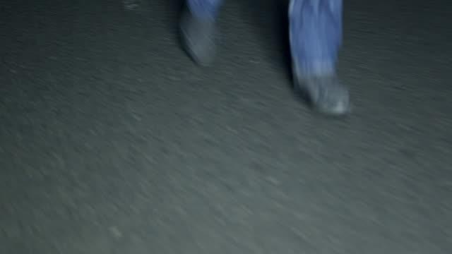 Feet running on dark street video