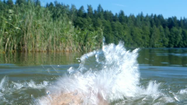 feet splashing water in the lake, summer, relaxation, vacation - dito del piede video stock e b–roll