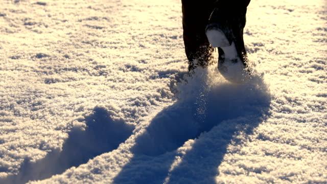Feet Walking Through Snow Woman's feet trudging through the snow. plow stock videos & royalty-free footage