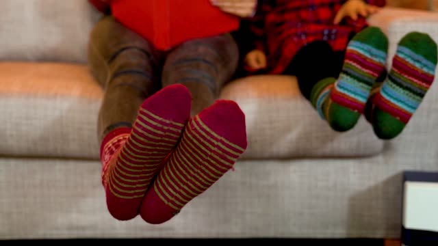 feet with colorful socks moving left and right - calzino video stock e b–roll