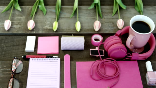Female accessories, stationery and coffee on table 4k video