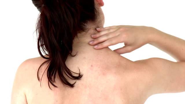 Female adult has pain in her neck video