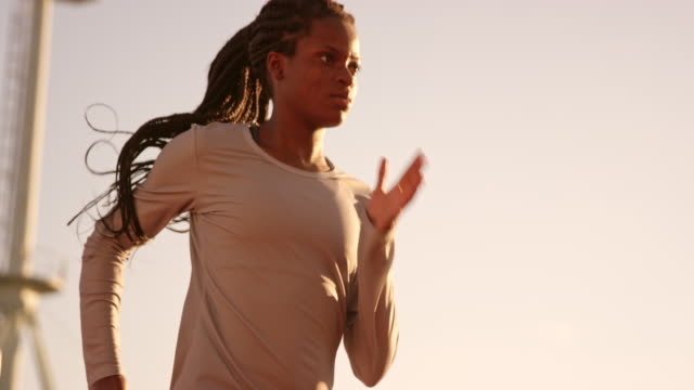 Slo Mo Ds Female Africanamerican Athlete With Long Braided Hair Running In Stadium At Sunset Stock Video Download Video Clip Now Istock