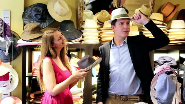 female and man choosing hats video