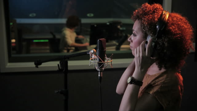 Female and technician in recording studio Female and technician in recording studio sound recording equipment stock videos & royalty-free footage