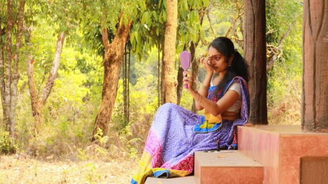 Female Applying Bindi video