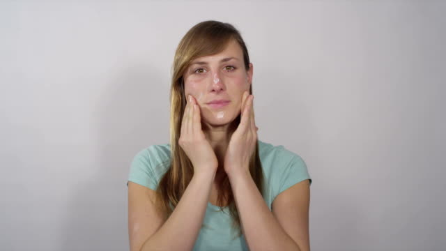 Female applying face cream video