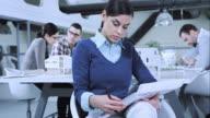 istock TU Female architect checking interior designs in meeting room 485787788