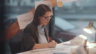 istock Female Architect Drawing Construction Plan at Office Desk 1252380465