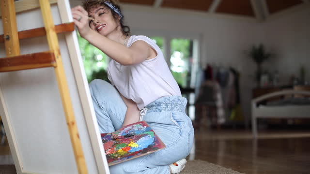 Female artist painting video