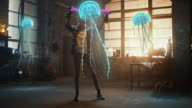 istock Female Artist Wearing Augmented Reality Headset Working on Abstract 3D Jellyfish Sculpture with Joysticks, Uses Gestures To Create High-Tech Internet Multimedia Concept Art.3D Animation Special Effect 1226183026