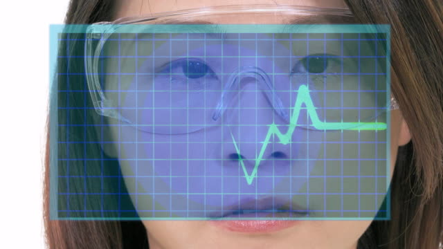 Female Asian doctor looking at virtual medical screen Female Asian doctor looking at virtual medical EKG screen cardiologist stock videos & royalty-free footage