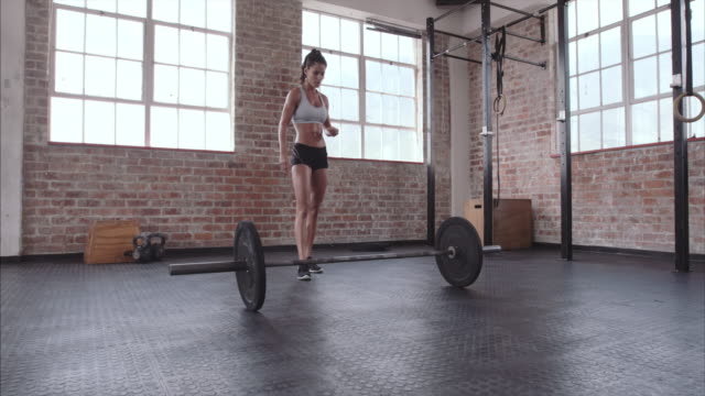 Female athlete doing weight lifting workout video