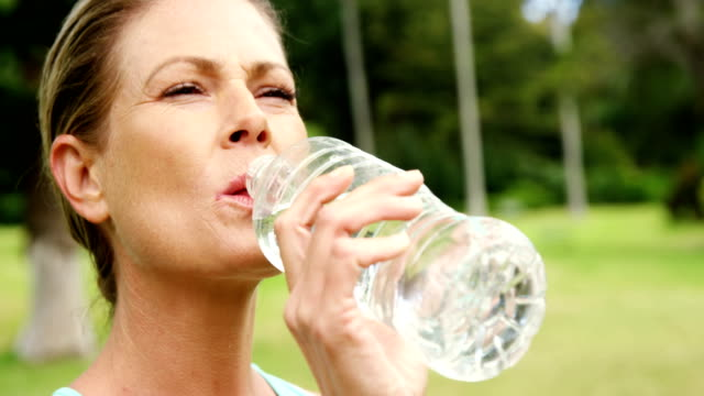 Female athlete drinking water video