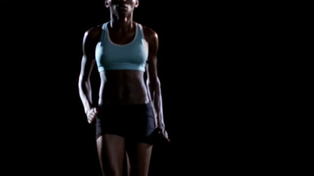 Female athlete high stepping. video