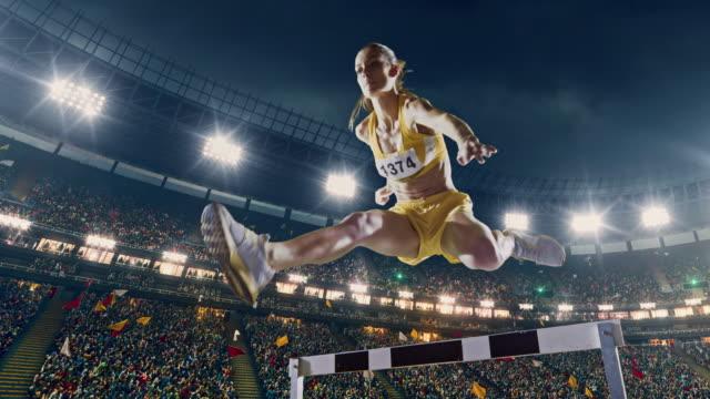 Female athlete hurdle on sports race video