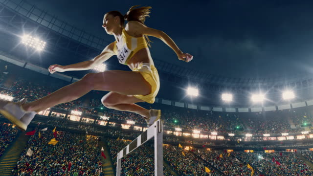 female athlete hurdle on sports race - track and field stock videos and b-roll footage