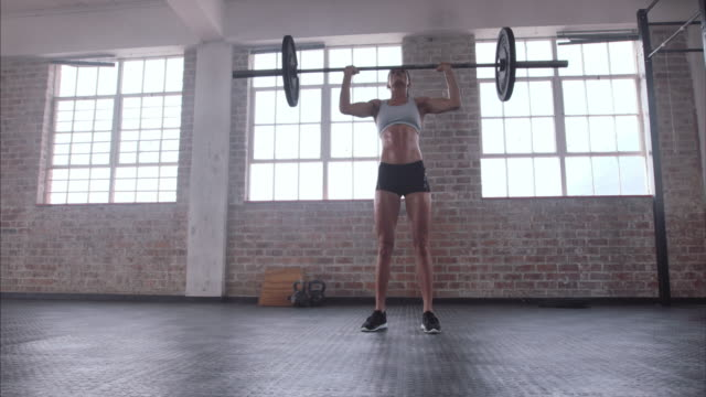 Female athlete practicing deadlift with weight bar video