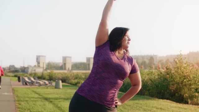 Female athlete stretching her arms and hands