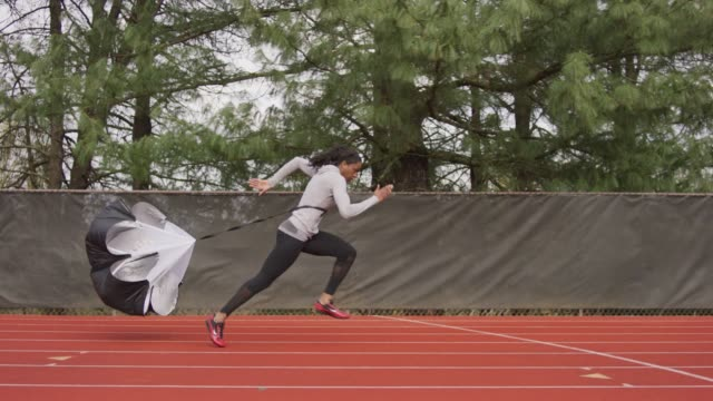 Female Athlete Training with a Parachute