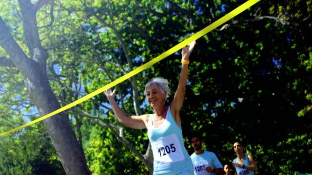 Female athlete winning the marathon race 4k