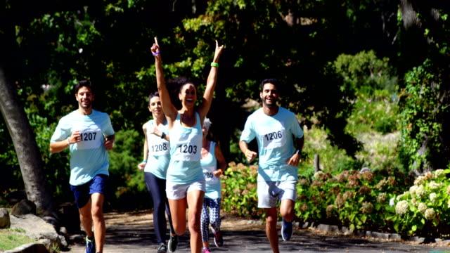 Female athlete winning the marathon race 4k video