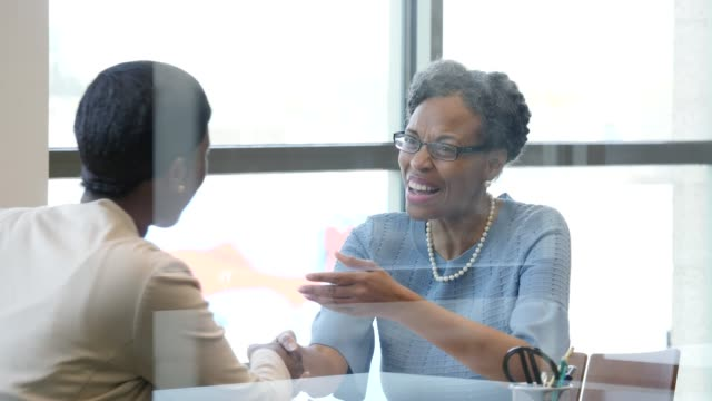 Female bank customer meets with loan officer