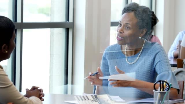 Female bank loan officer explains loan application process