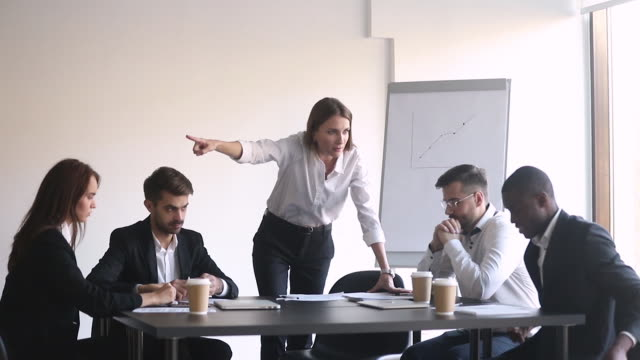 Female boss during group meeting asking to leave black employee