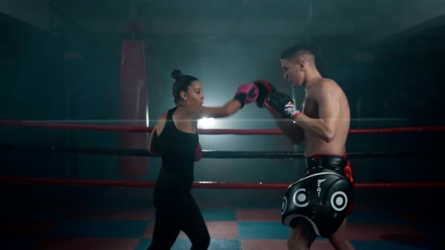 Female boxer on training class