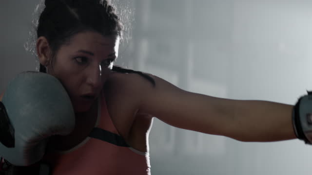 Female Boxer pad work session with trainer video
