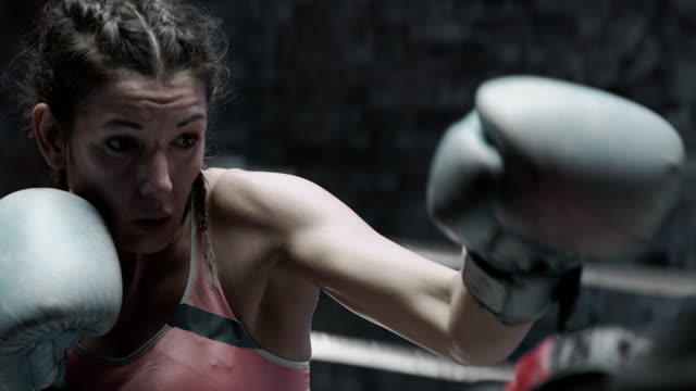 Female Boxer pad work session with trainer