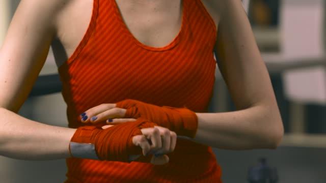 Female boxer preparing for training video