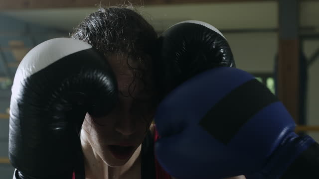 Female boxer protecting head in the boxing ring video