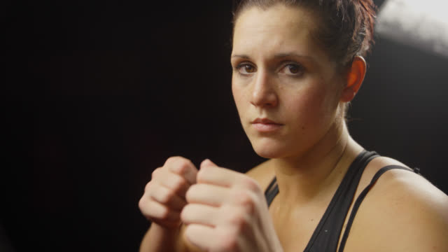 female boxer raises fists - mma stock videos and b-roll footage