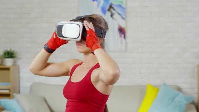 female boxer training in vr goggles - sparring allenamento video stock e b–roll