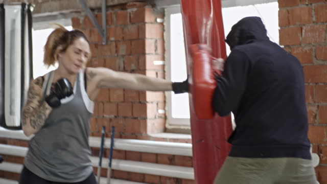 Female Boxer Training with Coach video