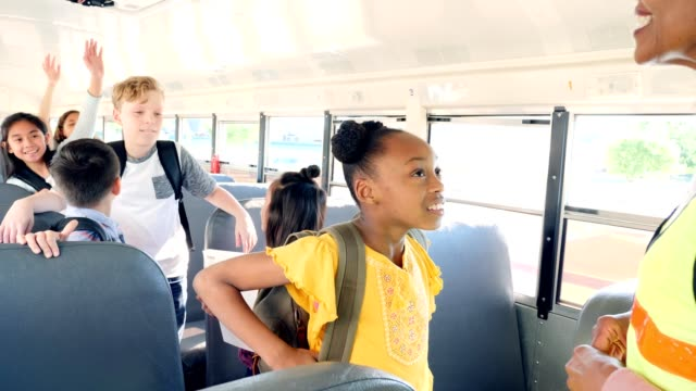 Female bus driver gives instructions to students video