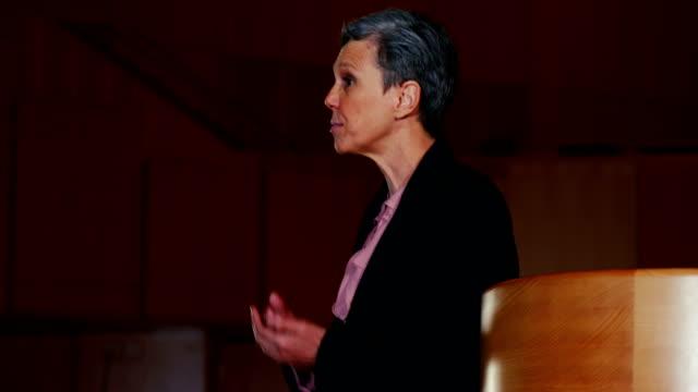 Female business executive giving a speech video
