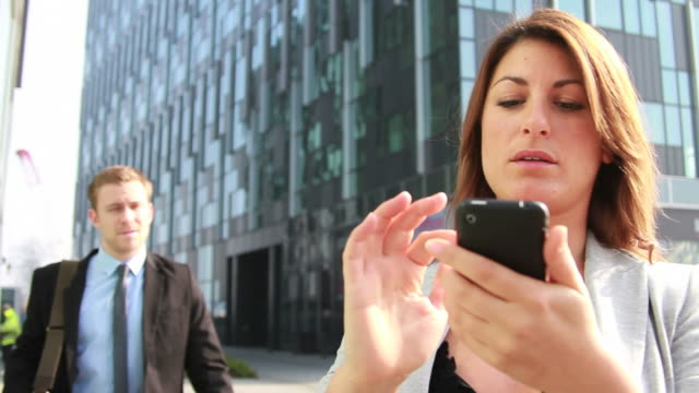 Female Business executive working on ditigal tablet outside of office video
