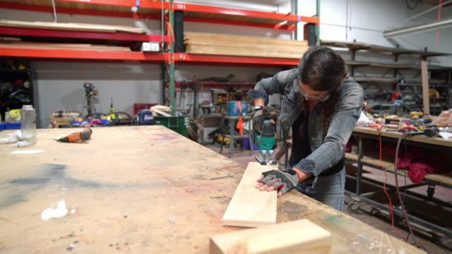Female carpenter cutting wood video