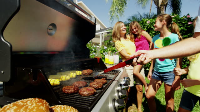 female caucasian children parents grilling fresh food outdoors - grilling stock videos & royalty-free footage