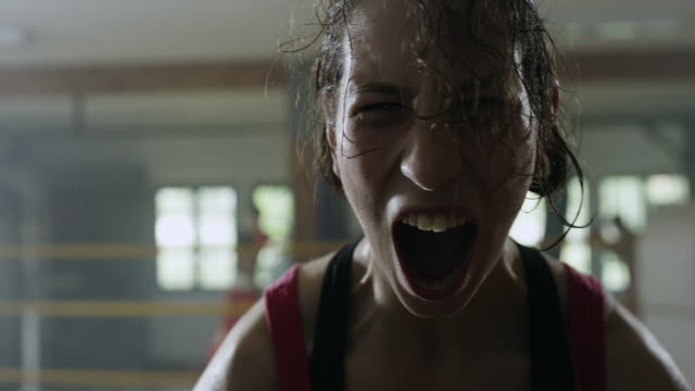 Female celebratory scream in boxing ring video