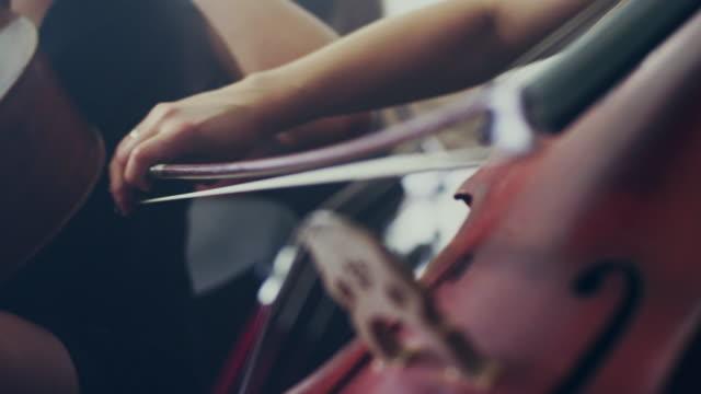 Female cello player playing violoncello. Woman violoncello player video